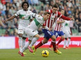 Elche's midfielder Ruben Perez vies with Atletico Madrid's midfielder Koke during the Spanish league football match Elche vs Club Atletico de Madrid at the Manuel Martinez Valero Stadium in Elche on November 30, 2013