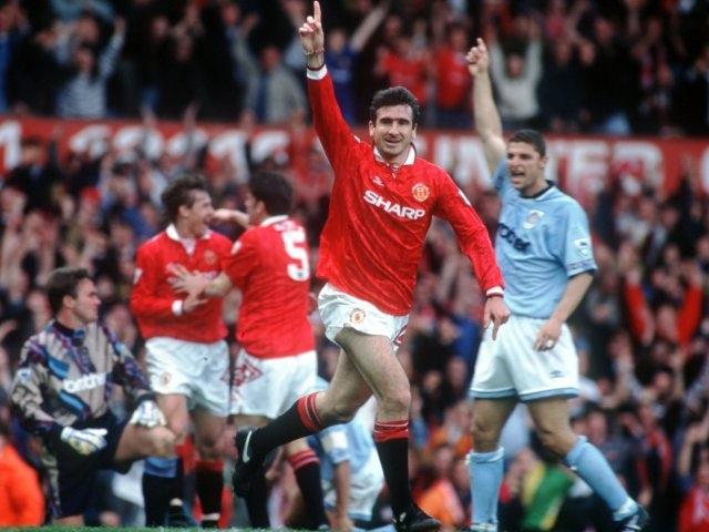 Eric Cantona celebrates scoring against Manchester City on April 23, 1994.