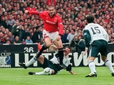 Eric Cantona in action for Manchester United against Liverpool on May 11, 1996.
