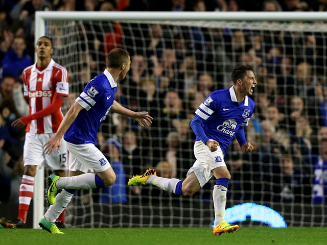 Bryan Oviedo of Everton celebrates after scoring his team's third goal during the Barclays Premier league match between Everton and Stoke City at Goodison Park on November 30, 2013