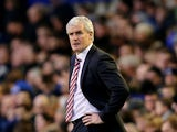 Manager of Stoke City Mark Hughes looks on during the Barclays Premier League match between Everton and Stoke City at Goodison Park on November 30, 2013