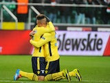 Lazio's Felipe Anderson is congratulated by teammate Brayan Perea after scoring his team's second goal during their Europa League group match on November 28, 2013