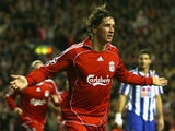 Fernando Torres of Liverpool celebrates scoring the opening goal during the UEFA Champions League Group A match between Liverpool and FC Porto at Anfield on November 28, 2007