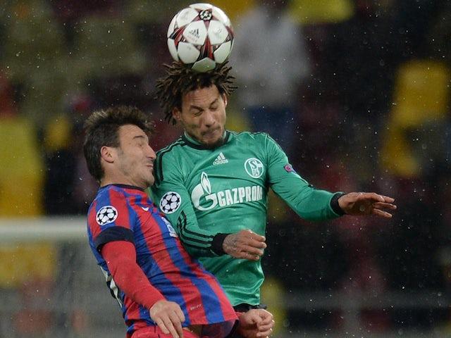 Bucharest's midfielder Gabriel Iancu and Schalke's US midfielder Jermaine Jones vie for the ball during the UEFA Champions League Group E football match on November 26, 2013