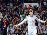 Real Madrid's Welsh striker Gareth Bale celebrates after scoring a goal during the Spanish league football match against Real Valladolid CF on November 30, 2013