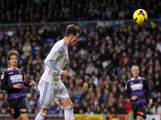 Gareth Bale of Real Madrid CF scores Real's opening goal during the La Liga match between Real Madrid CF and Real Valladolid CF at Santiago Bernabeu stadium on November 30, 2013