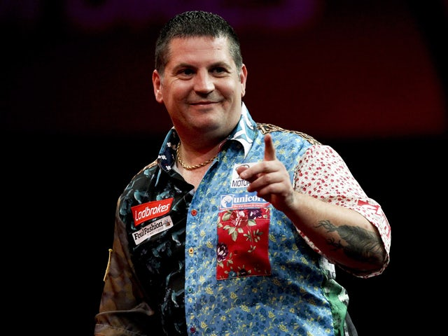 Gary Anderson of Scotland celebrates his win during his second round match on day eight of the 2013 Ladbrokes.com World Darts Championship at the Alexandra Palace on December 21, 2012