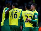 Gary Hooper of Norwich is congratulated by teammates after scoring the opening goal during the Barclays Premier league match between Norwich City and Crystal Palace on November 30, 2013
