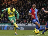 Norwich City's Gary Hooper shoots to score a goal during the English Premier League football match between Norwich City and Crystal Palace at Carrow Road in Norwich on November 30, 2013