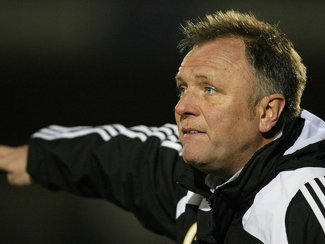 Gary Simpson gives instructions during the npower League Two match between Northampton Town and Macclesfield Town at Sixfields Stadium on February 21, 2012