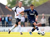 George Moncur of West Ham controls the ball from Elliot Buchanan of Boreham Wood during a Pre-Season Friendly match between Boreham Wood FC and West Ham United at Meadow Park on July 10, 2012