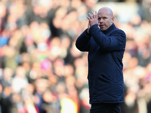 Blackburn Rovers manager Henning Berg shows his dejection as he applauds his fans at the final whistle after the npower Championship match between Burnley and Blackburn Rovers at Turf Moor on December 2, 2012