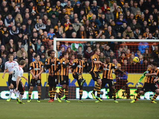 Steven Gerrard of Liverpool scores with a free kick during the Barclays Premier League match between Hull City and Liverpool at KC Stadium on December 1, 2013
