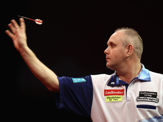 Ian White of Great Britain throws against Robert Thornton of Great Britain during day three of the 2012 Ladbrokes.com World Darts Championship at Alexandra Palace on December 17, 2011