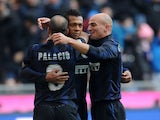 Inter Milan's Fredy Guarin celebrates after scoring a goal with Argentinian midfielder Esteban Matias Cambiasso Rodrigo Palacio during the Serie A match between FC Internazionale Milano and UC Sampdoria at San Siro Stadium on December 1, 2013