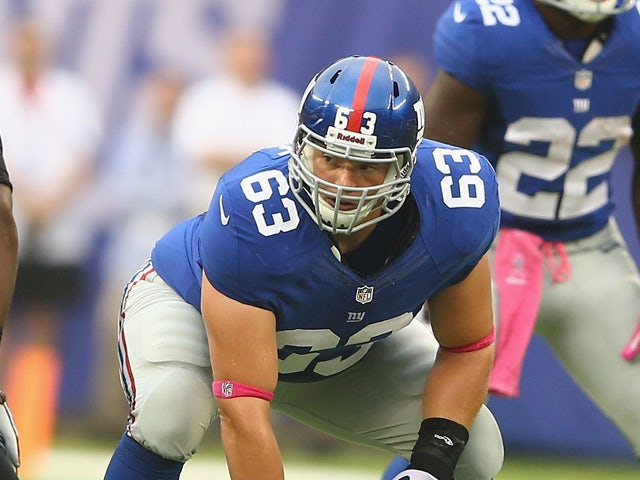 Jim Cordle #63 of the New York Giants in action against the Philadelphia Eagles during their game at MetLife Stadium on October 6, 2013