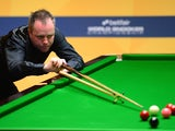 John Higgins of Scotland in action during his first round match against Mark Davis of England during the Betfair World Snooker Championship at the Crucible Theatre on April 22, 2013
