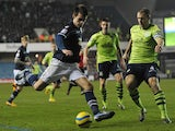 Millwall's English striker John Marquis shoots at goal during the English FA Cup fourth round football match between Millwall and Aston Villa at The Den in south-east London on January 25, 2013