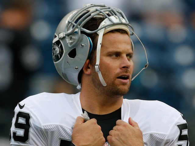 Long snapper Jon Condo of the Oakland Raiders looks on prior to the game against the Seattle Seahawks at CenturyLink Field on August 29, 2013