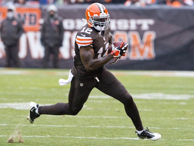 Wide receiver Josh Gordon #12 of the Cleveland Browns runs for a gain during the second half against the Pittsburgh Steelers at FirstEnergy Stadium on November 24, 2013