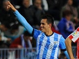Malaga's forward Juanmi celebrates after scoring during the Spanish league football match Malaga CF vs Athletic Club Bilbao at the Rosaleda stadium in Malaga on November 25, 2013