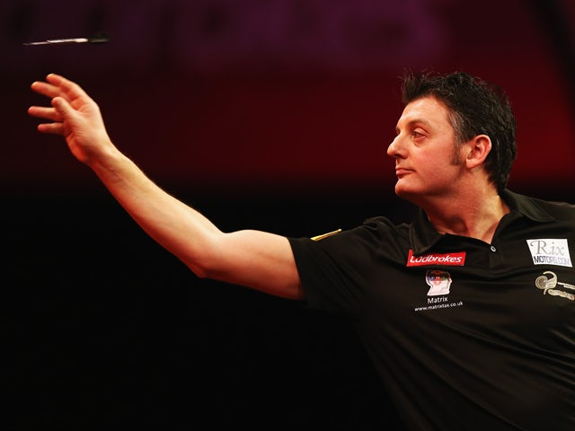 Justin Pipe of England in action during day 6 of the 2013 Ladbrokes.com World Darts Championship at Alexandra Palace on December 19, 2012