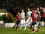 AC Milan's Brazilian forward Kaka (R) scores the opening goal during at the UEFA Champions League group H football match between Celtic and AC Milan at Celtic Park in Glasgow on November 26, 2013