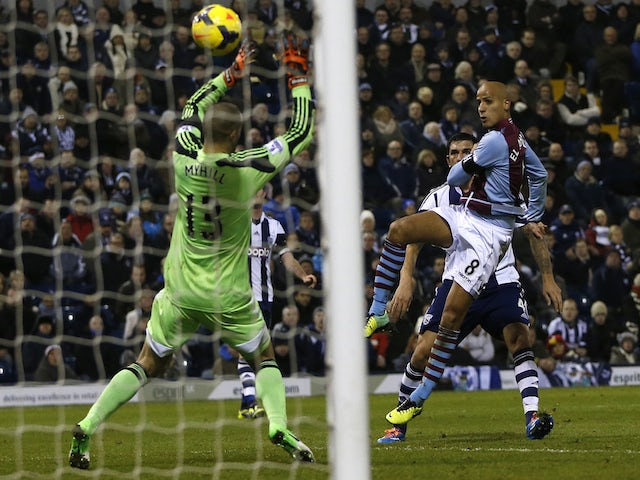 Aston Villa's Dutch-born Moroccan midfielder Karim El Ahmadi scores their first goal past West Bromwich Albion's US-born Welsh goalkeeper Boaz Myhill during the English Premier League on November 25, 2013