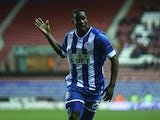 Wigan's Leon Barnett celebrates after scoring the opening goal against Zulte Waregem during their Europa League group match on November 28, 2013