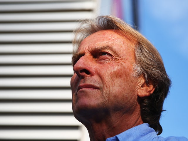 Ferrari Chairman Luca Cordero di Montezemolo talks to a friend in the paddock following qualifying for the Italian Formula One Grand Prix at Autodromo di Monza on September 7, 2013
