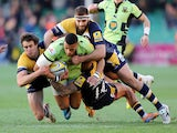 Luther Burrell of Northampton Saints is tackled by Ignacio Mieres, Sam Betty and James Stephenson of Worcester Warriors during the Aviva Premiership match on November 30, 2013