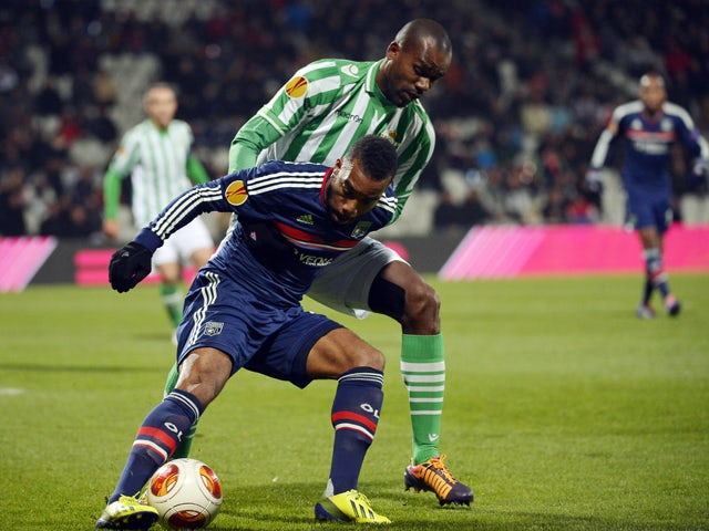 Real Betis Brazilian defender Paulao vies with Lyon's French forward Jimmy Briand during the Europa League football match Olympique Lyonnais vs Real Betis on November 28, 2013