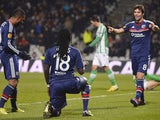 Lyon's French forward Bafetimbi Gomis celebrates with Lyon's French midfielder Yoann Gourcuff after scoring a goal during the UEFA Europa League football match Olympique Lyonnais (OL) vs Real Betis Seville on November 28, 2013