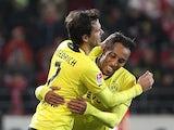 Dortmund's Gabonese striker Pierre-Emerick Aubameyang celebrates after scoring 1-0 during the German first division Bundesliga football match FSV Mainz 05 vs Borussia Dortmund in Mainz on November 30, 2013