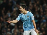 Samir Nasri of Manchester City celebrates his team's second goal during the Barclays Premier League match between Manchester City and Swansea City at Etihad Stadium on December 1, 2013