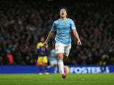 Samir Nasri of Manchester City celebrates his team's third goal during the Barclays Premier League match between Manchester City and Swansea City at Etihad Stadium on December 1, 2013