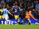 Samir Nasri of Manchester City scores his team's third goal during the Barclays Premier League match between Manchester City and Swansea City at Etihad Stadium on December 1, 2013