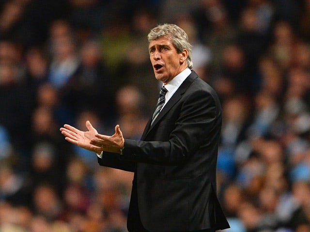 Man City manager Manuel Pellegrini on the touchline against Viktoria Plzen during his team's Champions League group match on November 27, 2013