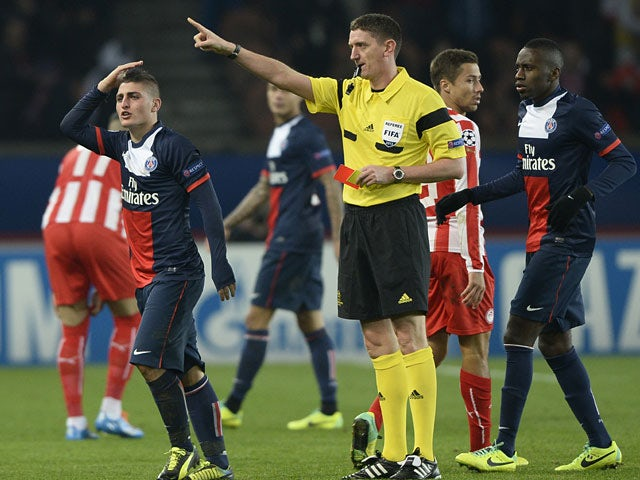 Paris Saint-Germain's Marco Verratti is sent off against Olympiakos during their Champions League group match on November 27, 2013