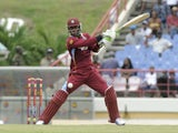 West Indies batsma Marlon Samuels hits Pakistan bowler Mohammad Irfan for 4 runs on his way to 106 not out during the 4th ODI West Indies v Pakistan on July 21, 2013