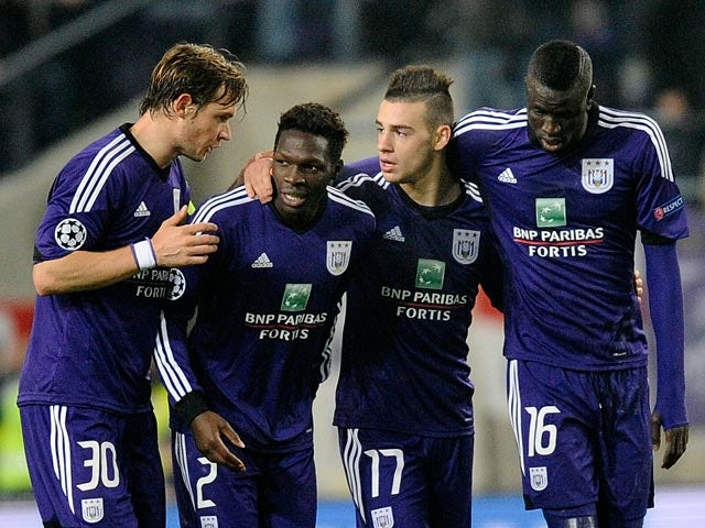 Anderlecht's Massimo Bruno celebrates with teammates after scoring his team's second goal against Benfica during their Champions League group match on November 27, 2013
