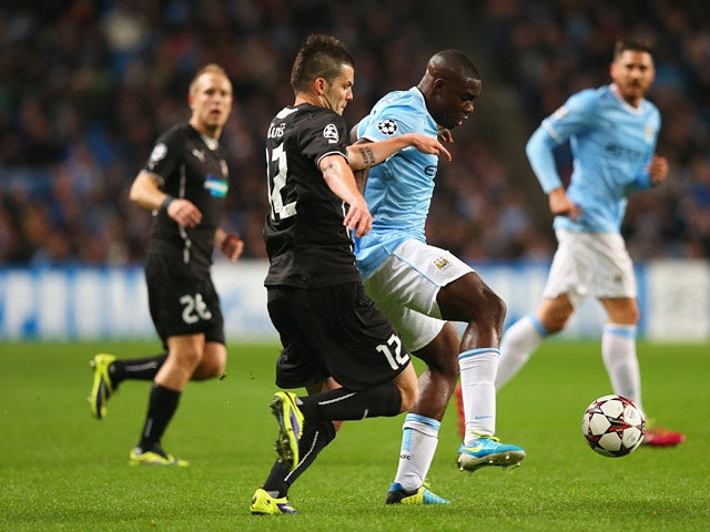 Viktoria Plzen's Michal Duris and Man City's Micah Richards battle for the ball during their Champions League group match on November 27, 2013