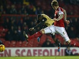 Moses Odubajo (L) of Leyton Orient shoots as Aden Flint (R) of Bristol City looks on during the Sky Bet League One match on November 26, 2013