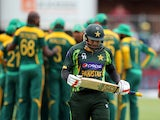 Pakistan's Nasir Jamshed walks off after South Africa's Dale Steyn gets his wicket during the second One Day International (ODI) Cricket Match between Pakistan and South Africa at the St Georges Cricket Ground in Port Elizabeth on November 27, 2013
