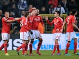 Benfica's Nemanja Matic is congratulated by teammates after scoring his team's opening goal against Anderlecht during their Champions League group match on November 27, 2013