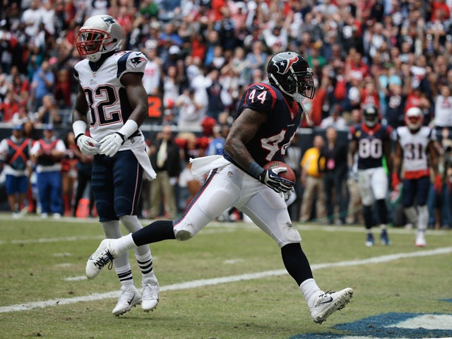 Ben Tate #44 of Houston Texans scores a first quarter touchdown past Devin McCourty #32 of the New England Patriots at Reliant Stadium on December 1, 2013