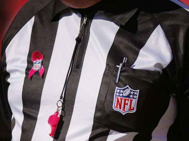 The NFL celebrates Breast Cancer Awareness month by the having referees wear pink apparel for the Kansas City Chiefs game against the Oakland Raiders October 13, 2013