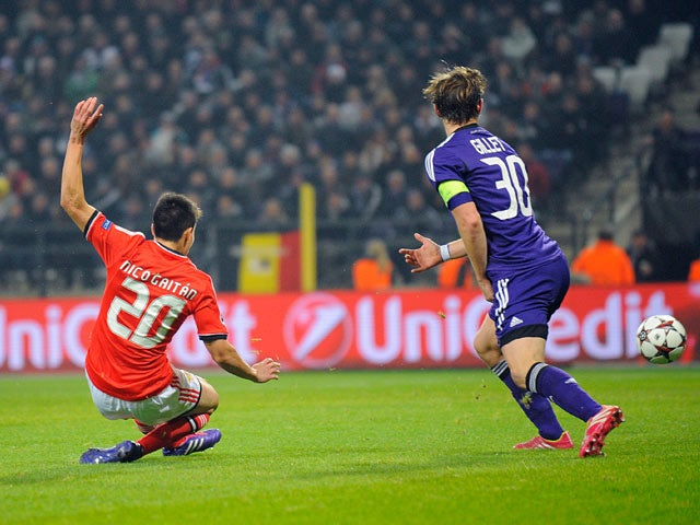 Benfica's Nicolas Gaitan scores his team's second goal against Anderlecht during their Champions League group match on November 27, 2013