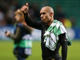 AC Milan's Dutch midfielder Nigel de Jong celebrates at full time during the UEFA Champions League group H football match between Celtic and AC Milan at Celtic Park in Glasgow on November 26, 2013