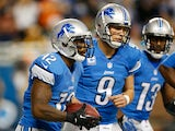 Jeremy Ross #12 of the Detroit Lions celebrates a second quarter touchdown with Matthew Stafford #9 and Nate Burleson #13 while playing the Green Bay Packers at Ford Field on November 28, 2013